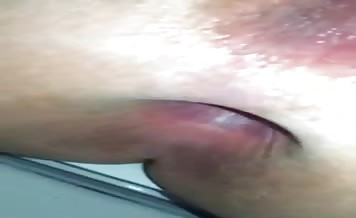 Shaved girl pooping in close up