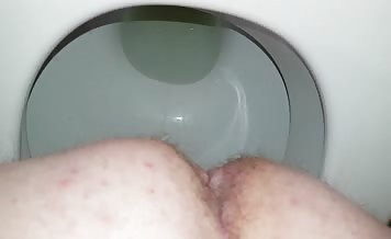 Mature man pooping in close up