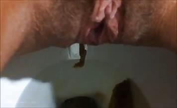 Hairy girl pooping in toilet