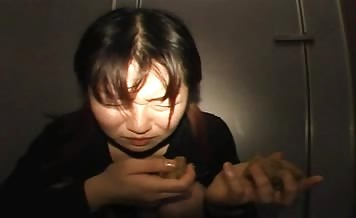 Japanese girl trying to eat her own shit
