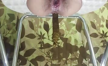 Hairy babe shitting on toilet