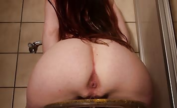 Beautiful brunette pooping a big one