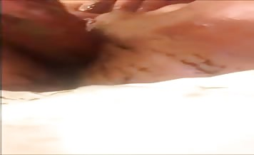 Smearing liquid shit on her pussy