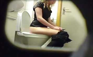 Blonde babe shitting in toilet
