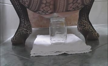 Hot wife shitting in a glass jar
