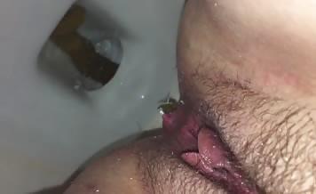 Close up of milf shitting