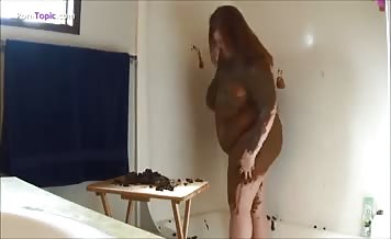 Covered her fat body with shit