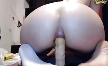 Shitting while riding a dildo