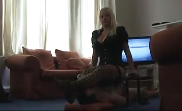 Beautiful blonde feeding her slave with shit