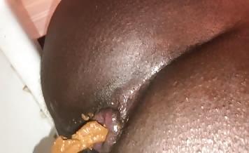 Black girl shitting over toilet
