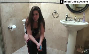 Cute girl pooping over toilet