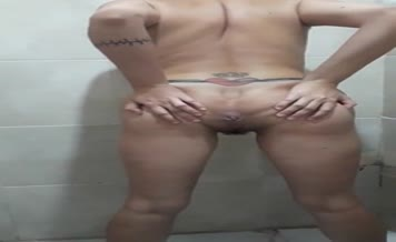 Masked tattooed babe shits on bathroom floor