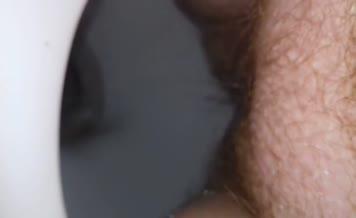 Close up of hairy babe shitting
