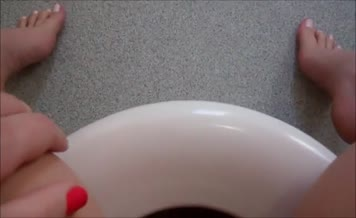 Fat wife peeing in toilet