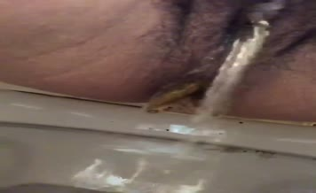 Hairy babe shits and pees