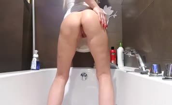 Tall blonde girl pooping in bathtub