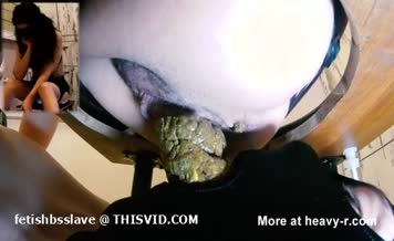 Big turd in slave's opened mouth