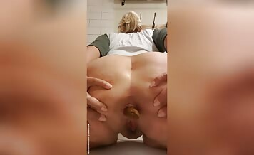 Beautiful blonde shits on her knees