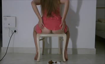 Dark haired babe shitting on wooden chair