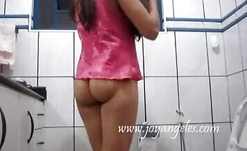 Shaved brunette pooping on bathroom floor