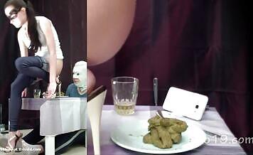 Masked brunette eats poop