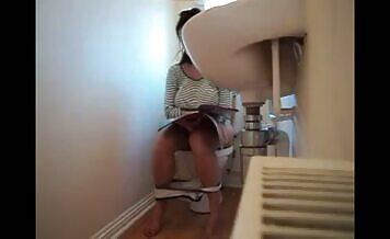 Cute brunette caught pooping
